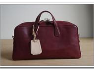 酒红植鞣牛皮斜挎包旅行袋
