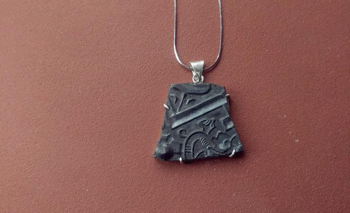 汉代神人柿蒂纹青铜镜残片